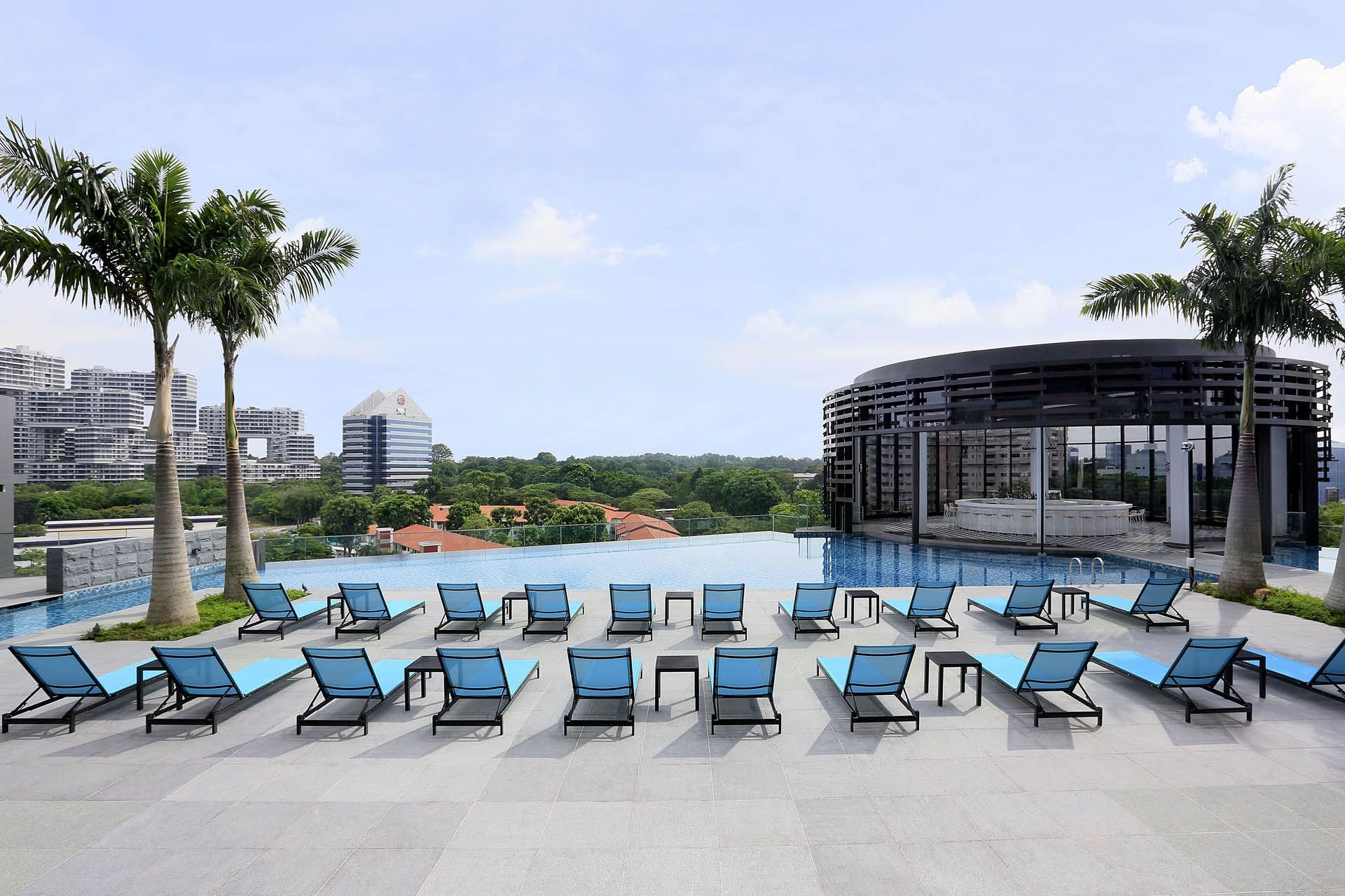 Spacious pool deck with sprawling views of natural greenery - Park Hotel Alexandra