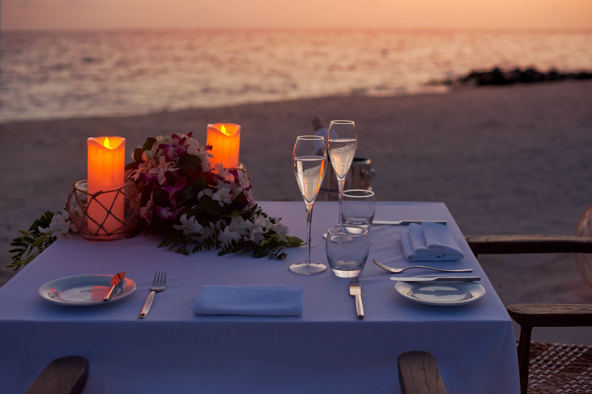 romantic dinner by the beach at sunset